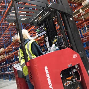 Image:  Forklift in warehouse.