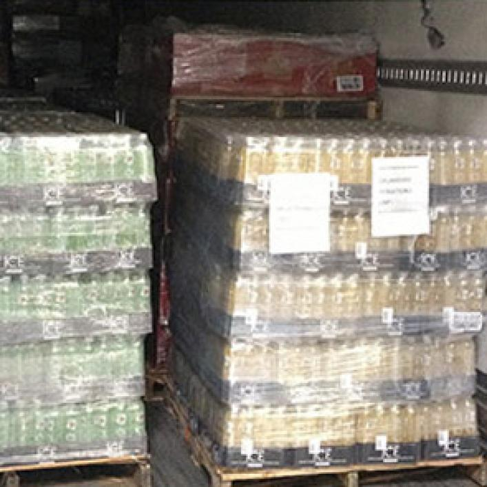 Images of packaged goods in the back of a delivery truck